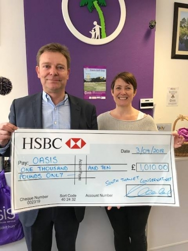 Craig Mackinlay presents cheque to Oasis